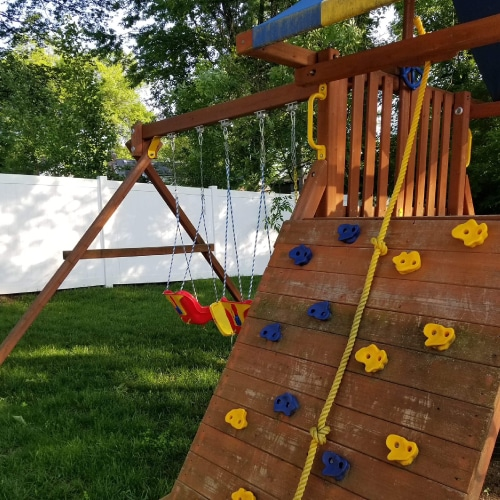 Play set in a back yard with mildew showing need for cleaning